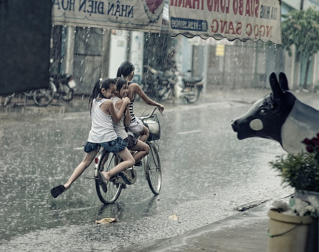 Kids Playing in Rain in Street